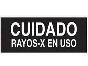 CAUTION X-RAY IN USE IN SPANISH